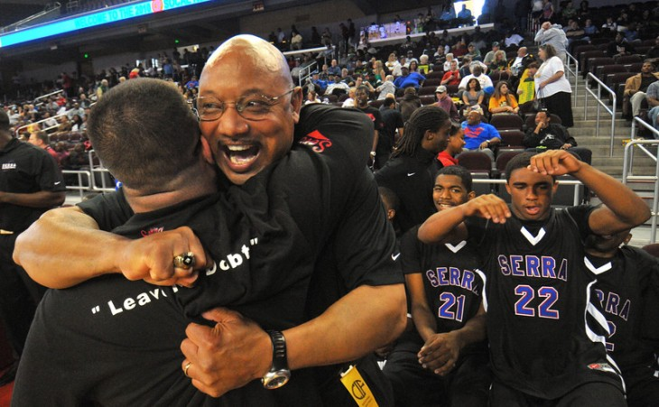 LOS ANGELES - 03/20/2010 - (Scott Varley/Daily Breeze) Serra boys basketball team beat Centennial 74-50 in the CIF SoCal Boys Div. III Regional Championships at USC's Galen Center. Serra coach Dwan Hurd hugs a staff member as he celebrates his team's win.
